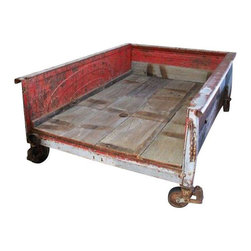 Vintage Ford Truck Bed on Wheels - Start Your Engines! This Vintage Ford Truck Bed has been artfully repurposed into a super cool piece.  We could see it as a bed frame in a boys room.  Or use it outside as a patio sofa: throw down a sisal and load it with all-weather pillows (we have those too!).  The options are endless.