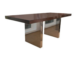 Dunbar Rose Wood desk by Roger Sprunger - Masterful and iconic rosewood and chrome plinth desk designed by Roger Sprunger and manufactured by Dunbar Furniture in the 1960′s. Three hidden oak drawers with hidden pulls.