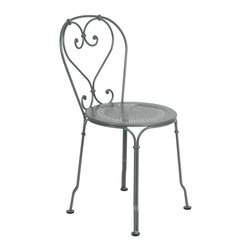 2201 Side Chair by Fermob - This whimsical bistro side chair reminds us of turn of the century design in France, and is hand-forged by a blacksmith in France, carrying on the tradition of design and craftsmanship.
