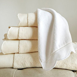 Frontgate - Overture Wash Cloth - 100% long-staple cotton. 600-gram solid velour towel. Machine washable. Imported. Make bath time feel more like a rich, relaxing spa experience with the Overture Towel Collection. Soft and luxurious, the 100% cotton towels feature a unique scalloped border that reverses to terry loops. . .  . .