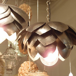 Lazy Susan Lighting - Looking for pendant lamps? Look no further than Lazy Susan Lighting. Visit their site and take your pick of innovative lighting solutions sure to add drama and interest to your room. These, pictured here, are my personal favorite, with their floral yet industrial vibe.