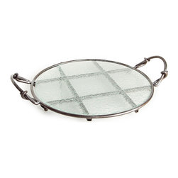 Danya B. - Round Textured Glass Platter on Iron Stand - Rustic elegance is yours when you use this round tray with textured glass to present your latest baking accomplishment. The flat, recycled glass surface is the perfect serveware for cakes, flan or a tray of hors d'oeuvres, and it easily removes to go in the dishwasher. The iron metal stand has hand-forged handles and a supportive checkerboard design beneath.