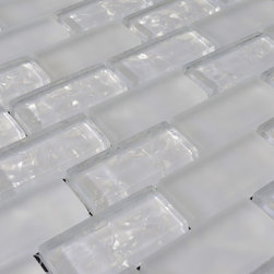 Glass Mosaic Tile - Product Description:Item#: COB0114Collection: Crystal Glass TileColor: Grystal WhiteSurface Finish: Glossy GlassShape: InterlockingChip Size: 1x2 In. (23mm x 48mm)Thickness: 5/16 In. (8mm)Each sheet of this glass tile is approximately 1 sq ft per sheet and is mesh mounted on high quality fiber glass for easy installation of your glass mosaic tile projects.Application: Glass mosaic tiles are impervious to the water, thus it is great for both interior and exterior use so moisture is not an issue. Mosaic glass tiles are great on floors and walls and have been most popular in bathrooms, spas, kitchen backsplash, wall facades and pools as well as a variety of other applications.Characteristics: Glass mosaic tile has a zero water absorption rate, and this tile exceeds ANSI standards for water absorption for mosaic tile. It is strong, durable, contamination free, and only the best quality tiles are selected as our tiles are inspected for blemishes before shipment.