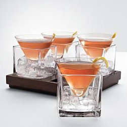 Cubist Martini Set - Sometimes I think overly fussy glassware takes away from what you're serving. Here, though, the presentation is clean enough that it just makes for a real conversation piece. I can also see this being used for a centerpiece when not holding a martini.