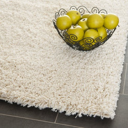 Safavieh - Safavieh Cozy Solid Ivory Shag Rug (2'3 x 9') - This cozy ivory shag rug will add warmth to any bathroom,bedroom,or hallway,and it features a one-inch polypropylene pile,making it plush and soft. The neutral color of this thick and easy-to-clean rug will match most home decors.
