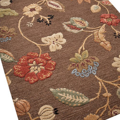 Jaipur - Garden Party Rug - Exuberant flowers dance across a field of textured rust or chocolate in this exquisite carpet. Hand-tufted in India from 100 percent New Zealand wool, the rug's playful design was inspired by ethnic textiles, but looks as fresh as a newly picked bouquet.