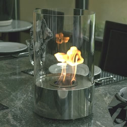 Bluworld - Accenda Tabletop Bio Ethanol Fireplace - The perfect accent to any table, in any setting. This portable tabletop fireplace features a polished stainless steel base and stunning tempered glass cylinder encasing the flames. Accenda tabletop bio-fireplace may be used indoors or out, however do not leave your fireplace outside exposed to the elements after use. Ships with snuffer. Fuel not included, we recommend using Nu-flame bio-ethanol fuel. Features: -Tempered glass for safety. -4 Liter capacity burner. -Quality stainless steel burner. -Snuffer tool. -Burns clean eco friendly bio-ethanol fuel. -1 Year warranty. -Suitable for indoor. -Tabletop. -Polished stainless.
