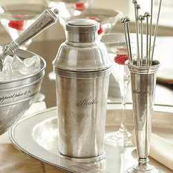 Antique-Silver Cocktail Shaker - Gift this stainless steel cocktail shaker to a family member, and get your holiday gathering off on the right foot. I like that you can engrave a person's name on it as well.