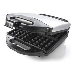 Krups® Waffle Maker - Four fluffy, delicious Belgian waffles are ready in minutes and release easily from the nonstick interior of this chrome countertop waffle maker. Permanent plates assure even browning; cool-touch handle keeps it comfortable. Ready light indicates when preheating is done. Convenient latch closure allows for compact upright storage.