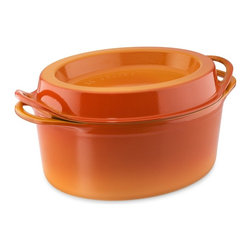 Le Creuset Cast Iron Oval Doufeu, Flame - This oval doufeu is designed to hold ice cubes in the lid to help create condensation over a hot pot for continual basting. Wow, right?