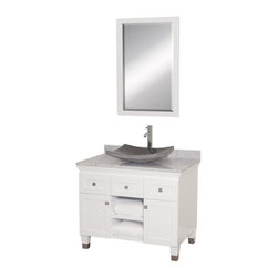 Wyndham Collection - Eco-Friendly Bathroom Vanity with Black Granite Sink - Includes natural stone counter, backsplash, one vessel sink and matching mirror. Faucets not included. Engineered to prevent warping and last a lifetime. Highly water-resistant low V.O.C. finish. 12 stage wood preparation, sanding, painting and finishing process. Floor standing vanity. Deep doweled drawers. Fully extending bottom mount drawer slides. Soft close concealed door hinges. Single hole faucet mount. Plenty of storage space. Brushed steel leg accents. Metal hardware with brushed chrome finish. Two doors and two drawers. White Carrera marble top. Made from zero emissions solid oak hardwood. White finish. Vanity: 36 in. W x 22.5 in. D x 36 in. H. Mirror: 24.25 in. W x 36.25 in. HCutting edge, unique transitional styling. A bridge between traditional and modern design, and part of the Wyndham Collection Designer Series by Christopher Grubb, the Premiere Single Vanity is at home in almost every bathroom decor, resulting in a timeless piece of bathroom furniture.