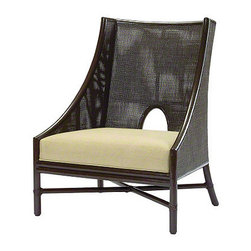 Barbara Barry Caned Lounge Chair: No. A-62 - The generous proportions of this Caned Lounge Chair by Barbara Barry offer an ample seat and backrest for luxurious comfort. A signature piece of the collection, the Barbara Barry Caned Lounge Chair is designed for comfort. The square back offers a delicate pattern of square mesh caning framed in rattan and accented by the collection's signature half-oval, cutout detail. A low-slung profile creates a dramatic silhouette, while deep seating provides added comfort. Rattan armrests gently curve from the high back to the front legs. When paired with the collection's Ottoman, the Barbara Barry Caned Lounge Chair becomes comfort and elegance personified.