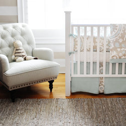 Picket Fence Baby Bedding 3-Piece Set - Some would shy away from using blue in a gender-neutral nursery, but I disagree. A steely blue is featured here with whites and tans in this crib bedding. Plus, I'm loving the chic Suzani print!