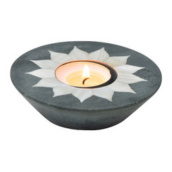 Sitara Collections - Palewa Stone Tea Light Holder with Inlay - The Beauty of inlay is Highlighted in this Hand-Carved Tea Light Holder. Meticulously Crafted of Dark soapstome, It Surrounds Your Tea Light with Beautiful Depictioms of Flower Petals That add an Elegant Yet Whimsical touch to any Space. Setting: indoors Type: ome (1) Tea Light Candle Holder Colors: Grey with White accents. ome Tea Light included (Unscented) Materials: Palewa soapstome. Dimensioms: 1.0 inches High X 4 inches Diameter.