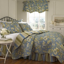 Waverly Augustine 4 pc. Quilt Set - The Waverly Augustine 4 pc. Quilt Set is a charming set perfect for dressing up your guest bedroom. This bedding set includes a reversible quilt, two ruffled pillow shams, and a tailored bedskirt. The quilt and shams feature a floral pattern in chambray blue, green, and honeydew. The bedskirt, sham ruffles, and reverse side of the quilt have a coordinating stripe pattern. Garden fresh! This machine-washable, 100% cotton quilt set comes in your choice of size.Quilt Dimensions:Full / Queen: 90L x 88W in.King: 90L x 104W in.About Ellery HomestylesOffering curtains, bedding, throws, and specialty products, Ellery Homestyles is a leading supplier of branded and private-label home-fashion products. Their products deliver innovation in fashion, function, and design and include names like Eclipse™, Curtainfresh™, SoundAsleep™ , ComfortTech™, Vue™, and Waverly. Their 357,000 square foot facility in Lumber Bridge, North Carolina includes a high-speed pillow-filling operation with a capacity of approximately 40,000 pillows a week.