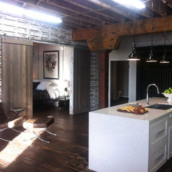 Downtown Loft - Sliding barn doors in Dry Brush + feature wall in White White by Timeline Wood