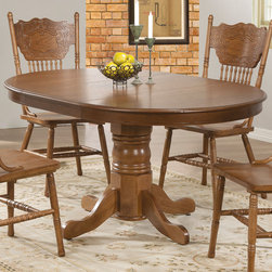 Coaster - Brooks Dining Table, Oak - This beautiful dining table and chair set will be a lovely addition to your breakfast nook or casual dining room. The smooth oval oak table top features a beveled edge and plain apron. A pretty turned pedestal base gives this piece just the right touch of traditional charm. The traditional oak chairs will fit nicely into your room, with splat backs featuring an intricate pressed design and turned supportive spindles. Turned legs complete these chairs, in a beautiful oak that will blend with your decor.