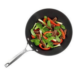 Calphalon Unison non-stick 13 in. Flat Bottom Wok & Cover - The non-stick surface of the Calphalon Unison non-stick 13 in. Flat Bottom Wok & Cover gives you the ability to stir fry foods without needing heavy oils or sauces to keep your meals from sticking to the pan. The non-stick surface is easy to clean, and the clear glass lid and metal handles are even oven safe up to 500 degrees.About CalphalonCalphalon's mission is to be the culinary authority in kitchenwares, enhancing the home chef's food experience during planning, prep, cooking, baking, and serving. Based in Toledo, Ohio, Calphalon is a leading manufacturer of professional quality cookware, cutlery, bakeware, and kitchen accessories for the home chef. Calphalon is a Newell-Rubbermaid company. Calphalon's goal is to give you, the home chef, all the tools you need to realize your highest potential in the kitchen. From your holiday roasting pan to your everyday fry pan, count on Calphalon to be your culinary partner - day in and day out, for breakfast, lunch, and dinner for a lifetime.