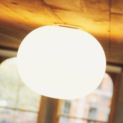 Flos Lighting - Glo-Ball Flushmount by Flos Lighting - As its name implies, the Flos Glo-Ball Flushmount is a glowing ball of light overhead. When turned off, the hand-blown and acid-etched Opaline shade is a clean, bright White. When illuminated, however, the same shade diffuses a warm glow courtesy of the inner halogen light. Part of the Flos Glo-Ball collection designed by Jasper Morrison. Flos was first established in 1962 in Merano, Italy, to produce high quality modern lighting. This Italian lighting company continues to do so to this day by collaborating with talented international designers and researching the latest lighting technologies and materials. Resulting Flos lighting fixtures are daring and provocative, yet uphold the fundamental principles of good design.