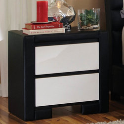 "Coaster - Kimball Night Stand - This impressive bedroom collection offers a new look. The group is completely upholstered and covered in black and white man-made leather giving it a fresh and unique appearance. Create an updated contemporary look in your teenager, guest or master bedroom space. Collection: Kimball; Style: Contemporary; Finish/Color: Black/White Finish; Full extension glides; Dimensions: 38.25""L x 15.75""W x 34.50""H"