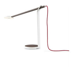 Koncept - Gravy LED Desk Lamp, Walnut Matte White Red Cord - Picture the latest LED technology wrapped up in a warm wood finish. That's Gravy – a low profile, compact desk lamp that brings style and warmth to your home or office. Edge lit technology in a circular LED head provides a soft, evenly distributed glow of warm light. The solid wood bar and base are offered in three different natural woods: light Maple, White Oak, and rich Walnut. Supporting the wood bar and LED head is a delicate aluminum stand. Controlling the light is easy – simply tap the center of the underside of the LED head to turn on or off, and touch and hold to dim or brighten the light. Gravy is also flexible, providing the user with perfect light placement. This simple yet elegant combination of wood, aluminum and LEDs are perfect to illuminate any environment.