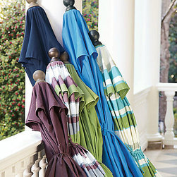 Outdoor Market Umbrellas - An outdoor table and chairs gets ramped up with color with these brightly colored umbrellas. Pull your colors from these, and your palette is set.