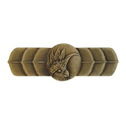 """Inviting Home - Left Horizontal Cockatoo Pull (antique brass) - Hand-cast Left Horizontal Cockatoo Pull in antique brass finish; 4-1/4""""W x 1-1/2""""H; Product Specification: Made in the USA. Fine-art foundry hand-pours and hand finished hardware knobs and pulls using Old World methods. Lifetime guaranteed against flaws in craftsmanship. Exceptional clarity of details and depth of relief. All knobs and pulls are hand cast from solid fine pewter or solid bronze. The term antique refers to special methods of treating metal so there is contrast between relief and recessed areas. Knobs and Pulls are lacquered to protect the finish. Alternate finishes are available. Detailed Description: If you are intrigued by fashionable and playful accessories than you will love the Cockatoo pulls - they come in vertical and horizontal options which would bring amazing variety without having to search at all. You can use the vertical pulls on the cabinet doors and the horizontal pulls on the drawers. If you have any smaller drawers you could also work in the Cockatoo Knobs making it a complete collection while displaying variety."""