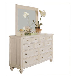 American Drew - American Drew Camden-Light Chest with Round Mirror in White Painted - The Camden-Light collection melds simple forms with quiet traditional references, gentle curves and a beautiful time worn ivory finish that lets the character of the wood show through. The brushed nickel finish hardware adds even more character to the Camden collection. This line will work great in your renovated farm house or a smaller beach cottage get-away.
