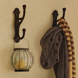 "Overscaled Hook, Cast Iron - Designed to hold heavier items, this substantial double hook saves floor and closet space. Sculptural scrollwork and smooth, curving lines lend elegance to the rustic finish. 2.75"" wide x 6.25"" deep x 13"" high Attaches to wall or the back of a door for coats, jackets, robes and other items. Made of cast aluminum with a rustic powdercoat finish. Includes mounting hardware. Sold individually. Catalog / Internet only."