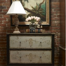 """Habersham - Habersham Tuscan Two-Drawer Chest with Art - It all started in the small North Georgia town of Clarkesville. It was 1969 and Habersham founder Joyce Eddy had just been given the chance to operate a small antique shop located above an old laundromat. This was just the opportunity a woman of Joyce's vision and energy would turn into the perfect blend of utility artistry and soul. Looking for ways to make her antique business more profitable she began crafting small decorative purses from vintage wooden cigar boxes. They were totally unique and they were an instant hit. Joyce named her new venture Habersham Plantation after Georgia's Habersham County and the plantations for which the area was known. The ideas just kept coming. One day Joyce was driving by a local textile company and spotted a large pile of old discarded wooden spools. Those spools were soon crafted into candleholders towel racks and folk art items. With the help of her sons and other family members Joyce expanded Habersham's offerings to include handcrafted furniture reflecting the American Country designs of the early 17th and 18th centuries. As word spread and production demands grew Joyce enlisted the help of woodworkers from her North Georgia region. This area had been a center for cabinetmaking since the early 1800s and the master craftsmen were well-schooled in the time-tested woodworking and joinery techniques that matched Joyce's sense of style and function. She even designed her factory to work just as the 18th century cabinetmakers did with individual artisans hand-finishing signing and dating each piece of furniture they crafted. Today Habersham still leads the way in the fine art of furniture design. So much so that in addition to their product line a new """"whole home"""" concept is finding its way into some of the finest dwellings in the country. Custom kitchen bath and other cabinetry designs offer rich opulent finishes and blend seamlessly with rooms of casual elegance all enhanc"""