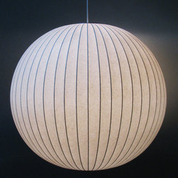 George Nelson Ball Lamp - George Nelson's Ball Lamp is one of the most popular lamps in the George Nelson Bubble Lamp collection and a Stardust Staff Pick.  Part of the permanent collection of New York's Museum of Modern Art, these stylish modern light fixtures have stood the test of time.  After more than half a century; the Bubble Lamps continue to be made by hand in a workshop in Michigan.  A single Ball Lamp is perfect as a dining room pendant light when suspended over a dining table.  Several Bubble Lamp styles and sizes can be suspended at different heights for a beautiful display. http://www.stardust.com/BALLLAMP.html
