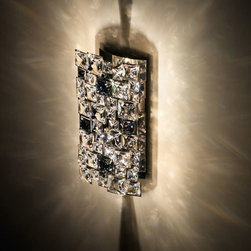Swarovski - Mosaix Wall Sconce - Mosaix wall sconce features a variety of square shaped Swarovski crystals with a stainless steel finish. Available in a wall sconce and pendant version. Two 25 watt, 120 volt, JCD Type G9 base halogen lamps not included. General light distribution. ADA compliant. UL listed. 6.1W x 12.2H x 3.54 inch depth.