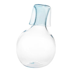 Esque - Off Pitcher + Cup, Extra Light Blue - Like the contestant on a TV singing show, this carafe is slightly off pitch. Only in this case, that's a good thing. Hand-crafted from your choice of clear or light blue glass, it would look great filled with water and placed on a nightstand. The matching glass even doubles as a lid.
