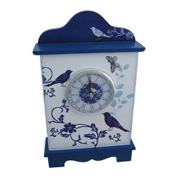 Blue and White Birdhouse Wooden Table/Wall Clock - This beautiful blue and white birdhouse inspired table clock makes a great gift for your favorite bird enthusiast. Made of wood, it measures 13 1/4 inches tall, 8 1/4 inches wide, 2 1/2 inches deep, with the clock face measuring 4 inches in diameter. Pull the clock face straight out to install 1 AA battery (not included), and to set the time. The clock features quartz movement, and has Roman numerals, black hour and minute hands, and a red second hand to mark the time. This piece also has a hanger on the back, so you can mount it to the wall or display it on a shelf or table.