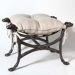 Bow Wow Bench - Stately hunting-lodge style meets with a hint of companionable whimsy in the Bow Wow Bench, a stunning seat with lines inspired by the campaign and neo-Classical stylings of two centuries past. With a graceful retriever's head alert at every corner, this backless seat is cast from solid iron for a sturdy weight and includes a linen cushion with draping ties.