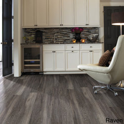 None - Harwich Oak Luxury Vinyl Plank Flooring - Give your home a refreshing new look with this Harwich oak vinyl plank flooring. In various wood finishes including ash blonde,raven,honey and chestnut,this floor covering provides the luxurious appearance of wood with the convenience of vinyl.