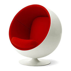 Ball Chair - Red - When sitting becomes more than a verb, when it is elevated to an actual experience, you know you have just been gifted an education from the genius that is Eero Aarnio. Certainly the Ball Chair is not for the faint of futuristic heart. Perhaps it would look more appropriate on a sci-fi flick sound stage than in your grandmother's living room; and that is exactly the point. The Ball Chair, crafted out of fiberglass, creates a personal bio-sphere - emphasis on sphere - right in the midst of your own household. Once you snuggle down into the Aarnio chair, it supports any manner of sitting positions. Imagine curling into such lush comfort on a rainy day with that book you've been meaning to finish for months. You might finish the entire series before your friends or family can entice you out again. And the best part? It comes in red, white, blue, and for the serious clean-cut rebel: HOT PINK!