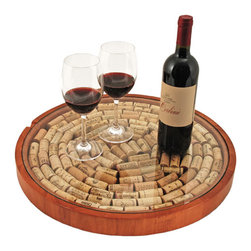 Lazy Susan Cork Display - You can measure your life in coffee spoons, but why not measure it in glasses of wine instead? Remember every occasion you popped a cork by keeping each cork in this functional display.