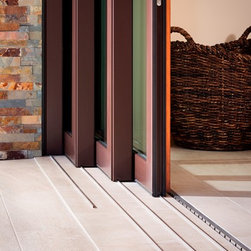 Pacific Architectural Millwork Slide and Seal Doors - Pacific Architectural Millwork's Slide and Seal door system.  All the advantages of a Lift and Slide without the big ugly handles.  Recessed flush drainage track for a seamless transition.