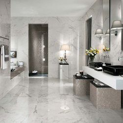 Atlas Concorde Marvel Bathroom - This image features multiple tiles from Atlas Concorde's new series Marvel. We absolutely love this new line. The tiles on the floor and walls are the Calacatta Extra Lappatto in the 18″ X 36″ size.