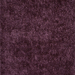 Jaipur Rugs - Solid Pattern Polyester Purple Shag  Rug ( 3.6x5.6 ) - Personal expression reaches new heights with Flux, a beautiful range of plush, hand-woven shag rugs of 100% polyester. This �chameleon� is ideal for the contemporary design lover who enjoys mixing up his or her personal space often � acting as a rich background to a diverse palette of furnishings and accessories. Highly textured shag construction brings comfort underfoot while a palette of fashionforward solid hues commands attention in any room.