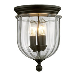 3 Light Flush Mount - This Three Light Flush Mount is part of the Warwick Collection and has a Bronze Finish and Clear Glass.  It is Dry Rated.