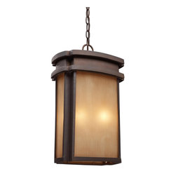 Elk Lighting - Elk Lighting Sedona Traditional Outdoor Hanging Light X-2/34124 - This Elk Lighting Sedona traditional outdoor hanging light is a bold and striking piece. It has a simple, minimalist design, as evident in the clean lines with recessed edge of the frame in a clay bronze finish and warm, caramel beige glass shade. It's a fantastic two-light fixture to light up the outdoor space of both casual and elegant homes.