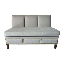 """Grey Upholstered Banquette with Nailhead Trim - A pair of modern grey banquettes with brass nail heads.  The clean look caters to a variety of aesthetics. The detailing on the tacks is elegant and pristine. The banquette is space efficient, comfortable, and a wonderful addition to any room. There is very minimal chipping on the legs (see pictures).Seat height of 18""""."""