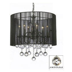 The Gallery - Crystal chandelier with Large Black Shade and 40MM Crystalalls - 100% crystal chandelier. A great European tradition. Nothing is quite as elegant as the fine crystal chandeliers that gave sparkle to brilliant evenings at palaces and manor houses across Europe. This beautiful chandelier has 6 lights and is decorated and draped with 100% crystal that captures and reflects the light of the candle bulbs. This wonderful chandelier also comes with the large shade as shown. The timeless elegance of this chandelier is sure to lend a special atmosphere anywhere its placed! This chandelier is dressed with spectacular Crystalalls which take the sparkle to an entirely new level of brilliance! This chandelier is dressed with spectacular Crystalalls which take the sparkle to an entirely new level of brilliance!
