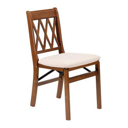 Stakmore - Lattice Back Folding Chair in Fruitwood Finis - Classic lattice back accents and top-quality solid wood construction give this pair of chairs smart style and exceptional value. A warm fruitwood finish completes each chair with expert attention to detail. Plus, each chair also features a padded, upholstered seat. Simply fold and store when finished. Set of 2. Traditional style. Classic criss-cross decorative back. Steel folding mechanism. Padded upholstered seat. Folds up to 7 in. deep for storage. Made from solid hardwood. No assembly required. 19.25 in. W x 16.5 in. D x 33 in. H. Seat height: 18.75 in.