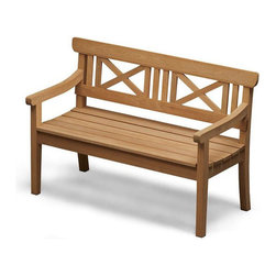 Skagerak Denmark - Drachmann Bench - Outfit your outdoor space in chic style with this classic Scandinavian bench. Designed by Bernt Santesson with a gorgeous cross back and an elegantly curved seat, it makes warming the bench a very enviable proposition.
