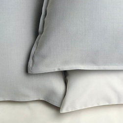 Area - Air 100% Organic Cotton Sham - Yarn dyed, subtle pattern that gives depth. A refined pale blueish grey like clouds.
