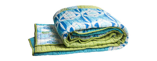 Rhadi Living - Medallion Twin Coverlet Blue/Green - Inspired by ikat and medallion block prints, this medallion, ikat and zig zag design repeats randomly over a great expanse of white in two color ways.  The print catches your eye as you try to follow the mesmerizing patchwork and repeat. Each quilt and sham is handmade, hand printed with cotton voile and cotton batting. Machine wash cold separately, delicate cycles, tumble dry low, do not bleach, iron at medium setting if necessary.