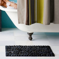 Massage Stones Bath Mat - Give your feet a treat right out of the bath for a soothing massage effect. These smooth stones get an extra polish after they're taken from the riverbed. Each bath mat is unique because of natural variations in the stones. Place this indoors or outdoors for a calming effect anywhere.